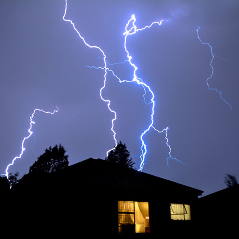 lightning crackling over a house